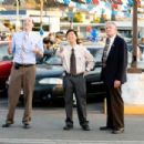 "(Left to right) It's a do or die weekend at Selleck Motors and everyone, including longtime salesmen Wade Zooha (Tony Hale), Teddy Dang (Ken Jeong) and Dick Lewiston (Charles Napier) know it, in the comedy ""The Goods: Live Hard. Sell Hard.&#82 - 454 x 303"