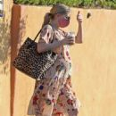 Emma Roberts – With a mask while out in Los Angeles