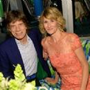Mick Jagger and actress Laura Dern attend HBO's Annual Primetime Emmy Awards Post Award Reception at The Plaza at the Pacific Design Center on September 22, 2013 in Los Angeles, California - 454 x 323