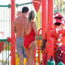 Billie Faiers in Red Swimsuit at a water park in Dubai - 454 x 449