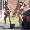 Jemma Lucy and Laura Alicia Summers in Bikini – Car Washing in Manchester - 454 x 414