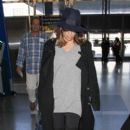Eva Longoria is seen at LAX October 17, 2016 - 400 x 600