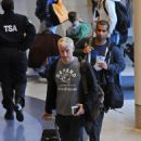 Cesar Recio follows Anderson Cooper to board their flight to Egypt at LAX, Thanksgiving week 2008