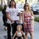 Dave Grohl and his wife Jordyn Blum take their daughter Violet out shopping in Beverly Hills - 422 x 594