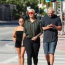 Amber Rose in Black Leggings – Out in Miami - 454 x 601
