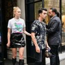 Sophie Turner in Black Mini Skirt and Boots – Out in New York