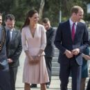 Prince William, Duke of Cambridge and Catherine, Duchess of Cambridge arrive at RAFF Base Edinburgh on April 23, 2014 in Adelaide, Australia
