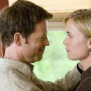 Greg Kinnear and Radha Mitchell