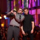 Zac Efron onstage during the 2016 MTV Movie Awards at Warner Bros. Studios on April 9, 2016 in Burbank, California