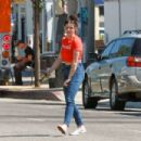 Ariel Winter – In a red t-shirt and blue jeans at Joan's On Third in Los Angeles