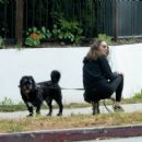 Troian Bellisario – Out for a walk with her dog in Los Angeles - 454 x 405