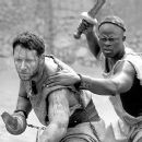 Chained together, Maximus (Russell Crowe) and Juba (Djimon Hounsou) get their first taste of gladiatorial combat in Dreamworks' Gladiator - 5/2000 - 400 x 259