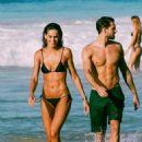 Izabel Goulart in Black Bikini at the beach in Brazil