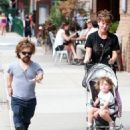 Peter Dinklage goes for a walk with his wife Erica and their daughter on August 27, 2015 in New York City, New York