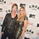 Duff McKagan and Susan Holmes McKagan attend CBGB Music & Film Festival 2014 - Michael Alago & Duff McKagan Film Talkson October 10, 2014 in New York City.