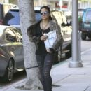 Michelle Rodriguez in Ripped Jeans Out Shopping in Beverly Hills - 454 x 564