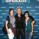 Musician Billy Idol  poses with fans backstage before performing for SiriusXM's Artist Confidential Series at The Troubadour on October 22, 2014 in Los Angeles, California