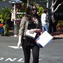 Michelle Trachtenberg in a leopard print jacket at Fred Segal in LA - 454 x 661