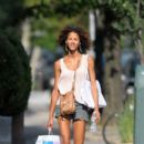 The stunning French model and actress Noemie Lenoir seen out and about in short shorts as she does errands in NYC
