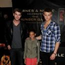 Liam Hemsworth, Amandla Stenberg and Alexander Ludwig attended a signing at Barnes and Noble in Los Angeles, March 22, to promote their new movie, The Hunger Games