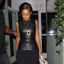 Rihanna shields her eyes from camera flashes as she leaves Il Ristorante di Giorgio Baldi - 351 x 594