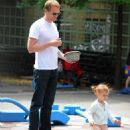 Paul Bettany plays in a park with daughter Agnes Lark