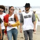Jared Leto enjoys the 4th of July hanging out on the beach in Malibu with some friends. The bearded rocker wears a black fedora, a grey sweatshirt and a white tank top that reads 'Malibu