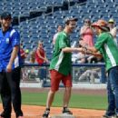 Chuck Wicks, Jonas Baade and Bret Michaels greet at City of Hope's 25th Annual Celebrity Softball Game at the new First Tennessee Park during CMA Music Festival in Nashville. - 454 x 321