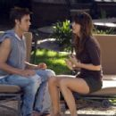 Dustin Milligan as Brad and Kristen Wiig as Suzie in EXTRACT. Photo Credit: Miramax Film Corp/Sam Urdank - 454 x 303