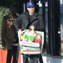 Robert Kardashian and some friends out shopping at American Rag in West Hollywood, California on December 15, 2012