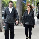 Yasmine Bleeth was spotted in Hollywood on Saturday 2/7, in sneakers and work-out pants taking a stroll with her husband, Paul Cerrito - 454 x 538