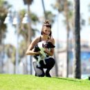 Nina Dobrev with Her Puppy Maverick at a Park in Los Angeles July 6, 2017 - 454 x 483