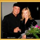 Metin Bereketli enjoying a friendly moment with lovely movie star Cheryl Ladd during the art exhibition Metin had for the Alzheimer's Association AWARE Ventura County fundraising event. - 454 x 429