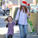 Alyson Hannigan and her daughter Satyana stop by a cafe before going to Whole Foods for some groceries in Santa Monica, California on December 24, 2013