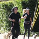 Singer Gene Simmons hit the streets with his wife Shannon Tweed for a run through the Hollywood, California hills on February 9, 2012.