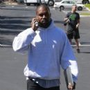 Kanye West has his hands full while attending a meeting in Calabasas, California on April 1, 2016