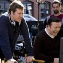 (L-r) Co-Director/Co-Writer MATTHEW ROBINSON and Co-Director/Co-Writer RICKY GERVAIS watch the playback monitors on the set of Warner Bros. Pictures', Radar Pictures' and Media Rights Capital's romantic comedy 'The Invention of Lying,'