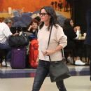 Courteney Cox and fiancee Johnny McDaid at LAX Airport in LA - 454 x 681