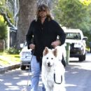 Billy Ray Cyrus takes his dogs out for a relaxing stroll through his neighborhood in Toluca Lake, California on April 4, 2014 - 453 x 594