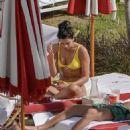 Dua Lipa – Wearing yellow bikini in Miami - 454 x 659