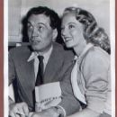 Evelyn Keyes and John Huston