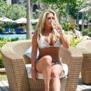 Bianca Gascoigne in Bikini on the pool in Dubai - 454 x 591
