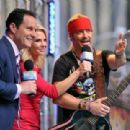 'FOX & Friends' co-hosts Brian Kilmeade and Elizabeth Hasselbeck talk to singer/TV personality Bret Michaels after his performance on 'FOX & Friends' All American Concert Series outside of FOX Studios on July 18, 2014 in New York City