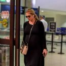 Kate Upton in Black Dress at LAX airport in Los Angeles