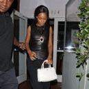 Rihanna shields her eyes from camera flashes as she leaves Il Ristorante di Giorgio Baldi - 410 x 594