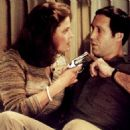 Chevy Chase and Sigourney Weaver