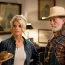 JESSICA SIMPSON as Daisy Duke and WILLIE NELSON as Uncle Jesse in Warner Bros. Pictures' and Village Roadshow Pictures' action comedy 'The Dukes of Hazzard,' also starring Johnny Knoxville and Seann William Scott and distributed by Warner - 454 x 302