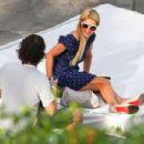 Paris Hilton Relaxing Poolside In Miami