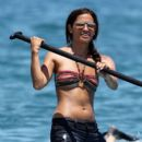 Rocsi Diaz enjoys a paddle board on the water while on vacation in Maui, Hawaii with Eddie Murphy and his family on June 14, 2012