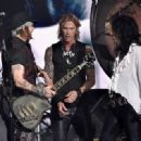 Bassist Duff McKagan, singer Alice Cooper and actor/musician Johnny Depp of Hollywod Vampires perform onstage during The 58th GRAMMY Awards at Staples Center on February 15, 2016 in Los Angeles, California.